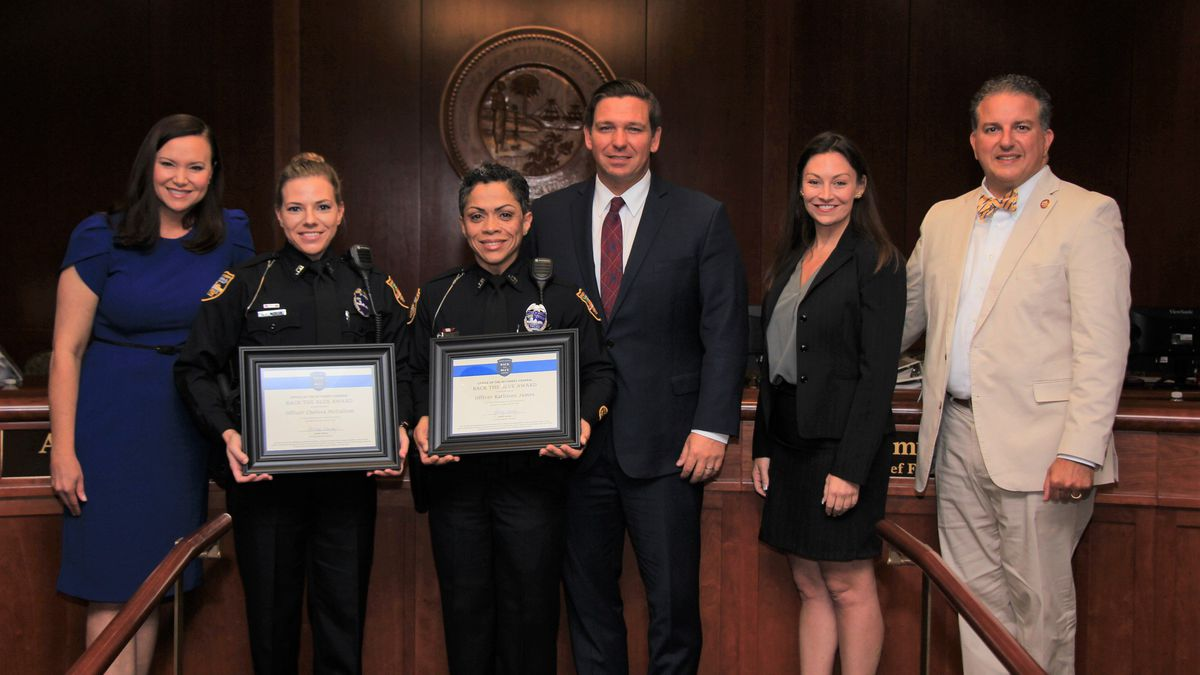 Back the Blue Award given to two Jacksonville officers for saving woman from burning car