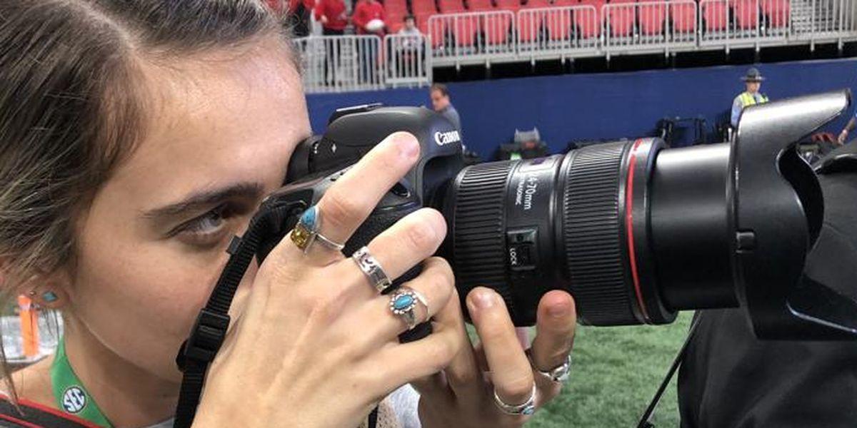 Injured UGA photographer back in action at SEC Championship game